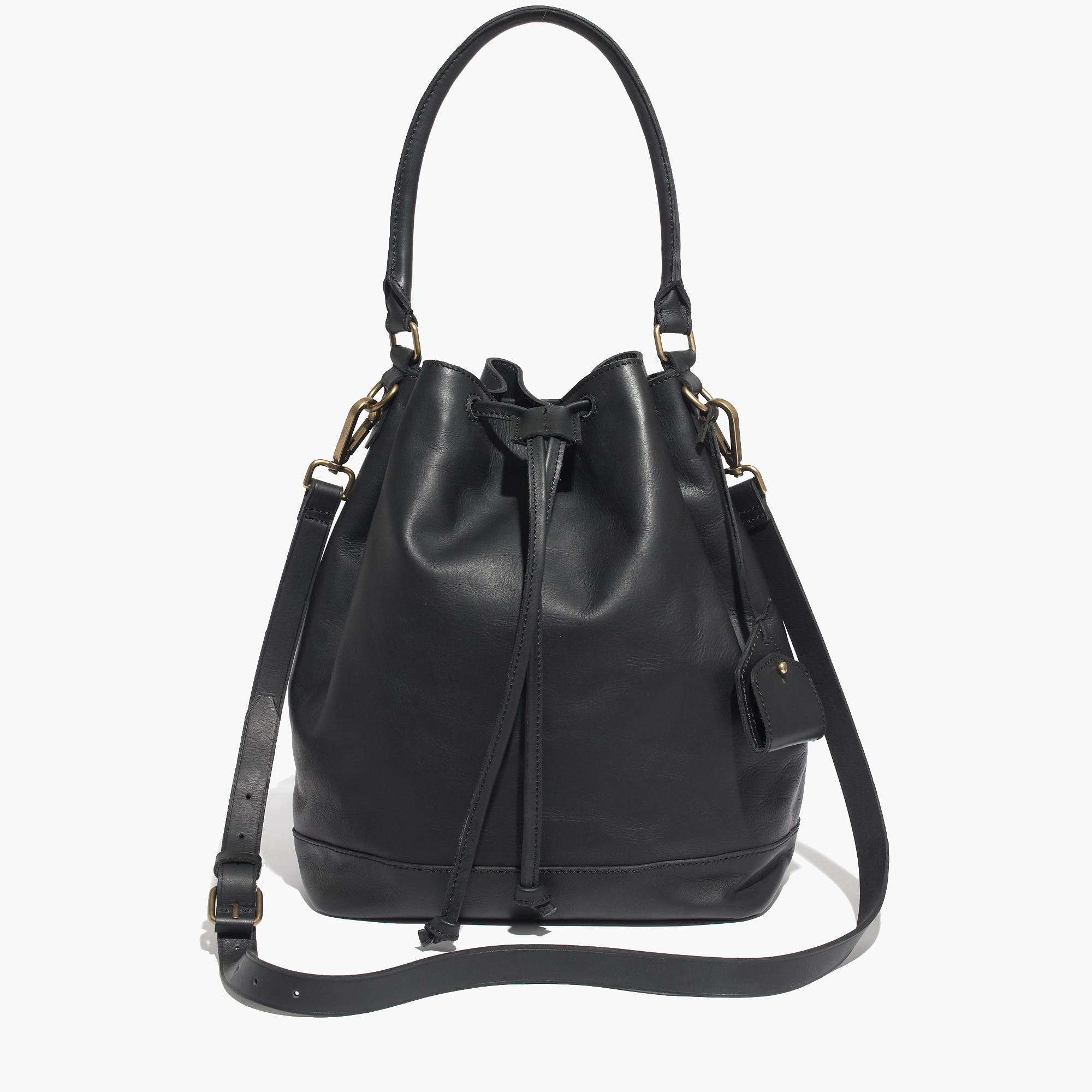 Large bucket bag in imitation leather with a handle, detachable shoulder strap and zip at the top. Unlined. Size approx. 15xx cm.